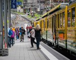 People alight from the train after the short but steep trip from Lauterbrunnen
